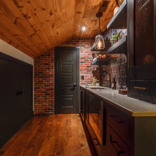 Small urban single-wall dark wood floor and brown floor wet bar photo in Raleigh with an undermount sink, recessed-panel cabinets, black cabinets, quartz countertops, black backsplash and ceramic backsplash