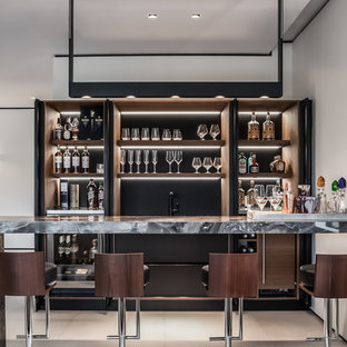 Design ideas for a large contemporary galley wet bar in Miami with dark wood cabinets, marble worktops, brown splashback, porcelain flooring and open cabinets.