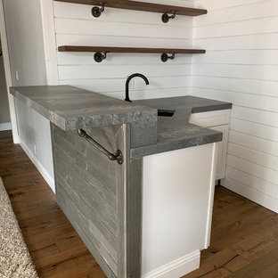 Inspiration for a small industrial l-shaped dark wood floor and brown floor wet bar remodel in Sacramento with an undermount sink, quartz countertops and gray countertops