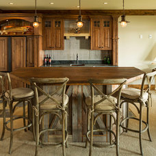 Traditional Home Bar by L. Cramer Designers + Builders