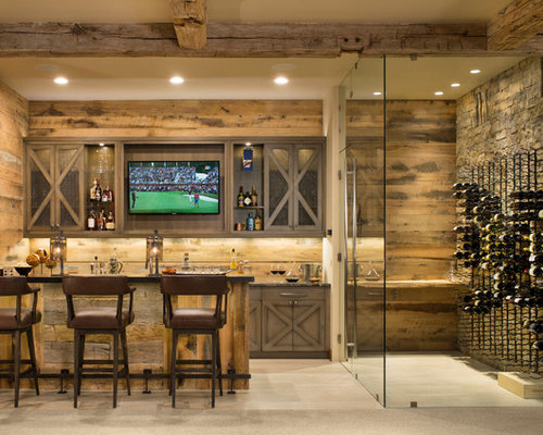 Example Of A Mountain Style Seated Home Bar Design In Denver