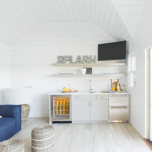 Inspiration For A Beach Style Light Wood Floor And Beige Wet Bar Remodel In Boston