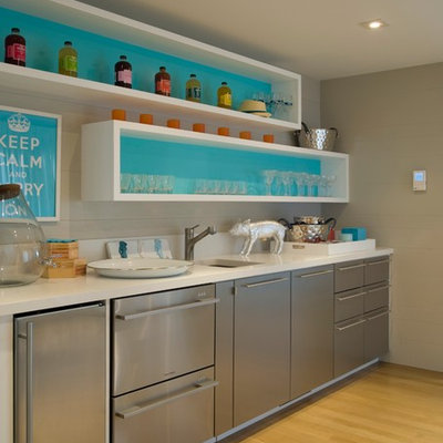 Beach style single-wall medium tone wood floor wet bar photo in New York with an undermount sink, flat-panel cabinets and white countertops