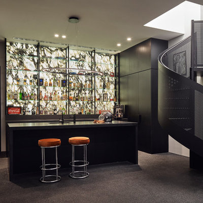 Seated home bar - mid-sized contemporary l-shaped black floor seated home bar idea in Melbourne with an undermount sink, black cabinets, granite countertops, multicolored backsplash, stone slab backsplash, black countertops and flat-panel cabinets