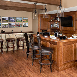 Inspiration for a mid-sized rustic l-shaped medium tone wood floor and brown floor seated home bar remodel in DC Metro with an undermount sink, dark wood cabinets, wood countertops, brown backsplash, wood backsplash and brown countertops