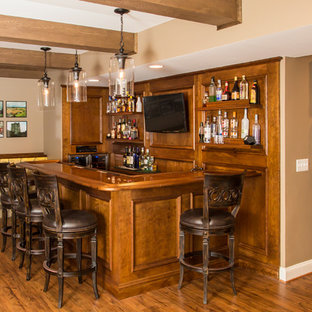 Inspiration for a mid-sized rustic l-shaped brown floor and medium tone wood floor seated home bar remodel in DC Metro with an undermount sink, dark wood cabinets, wood countertops, brown backsplash and wood backsplash