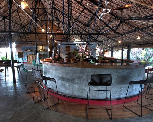 bar de salon exotique avec b ton au sol photos et id es d co de bars de salon. Black Bedroom Furniture Sets. Home Design Ideas