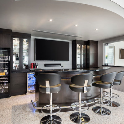 Large minimalist galley concrete floor seated home bar photo in Perth with furniture-like cabinets, dark wood cabinets and granite countertops