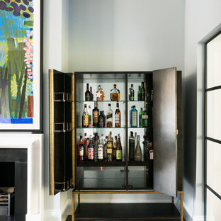 This is an example of a small contemporary bar cart in London with brown floors, flat-panel cabinets, black cabinets and medium hardwood flooring.