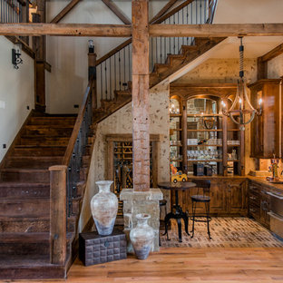 Inspiration for a rustic l-shaped brick floor home bar remodel in Houston with an undermount sink and dark wood cabinets