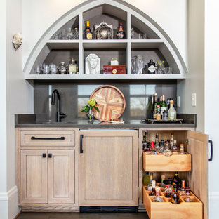 Wet bar - mid-sized industrial single-wall light wood floor wet bar idea in Charlotte with quartz countertops, gray backsplash, gray countertops and open cabinets