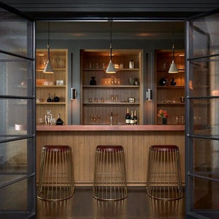 Photo of a traditional galley home bar in Los Angeles with open cabinets, medium wood cabinets, brown splashback, wood splashback and brown worktops.