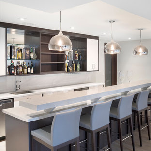 Large modern single-wall breakfast bar in Toronto with flat-panel cabinets, white cabinets and marble worktops.