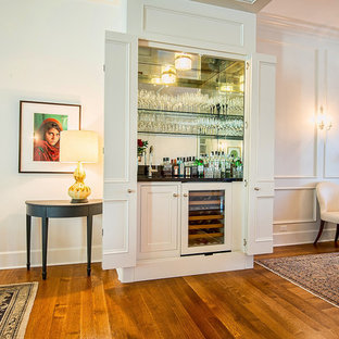 Example Of A Small Clic Single Wall Medium Tone Wood Floor Wet Bar Design In