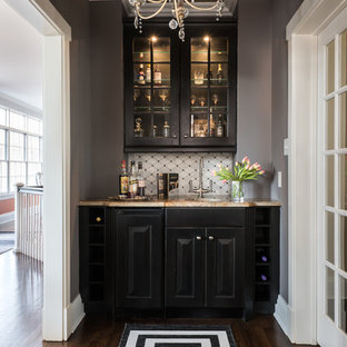 Example Of A Small Transitional Single Wall Brown Floor And Dark Wood Wet Bar
