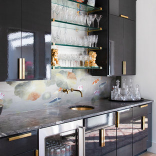 Design ideas for a medium sized contemporary single-wall wet bar in Austin with a submerged sink, flat-panel cabinets, black cabinets, marble worktops, black worktops, medium hardwood flooring and brown floors.