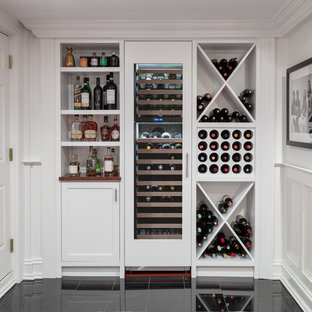 Example of a country single-wall black floor home bar design in Boston with no sink, open cabinets and white cabinets