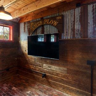 ボストンの中くらいのカントリー風おしゃれな着席型バー (ll型、家具調キャビネット、濃色木目調キャビネット、木材カウンター、レンガの床、赤い床) の写真