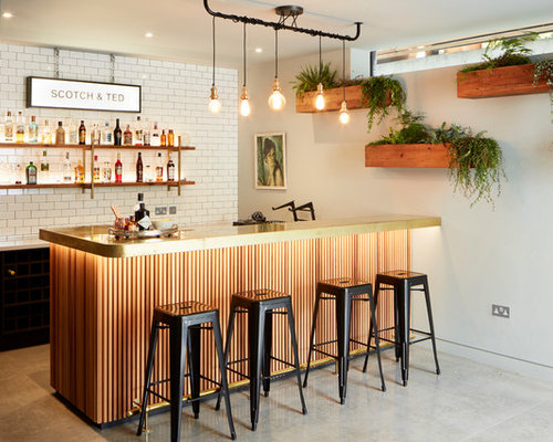 Example Of An Urban Galley Concrete Floor And Gray Floor Home Bar Design In  London With