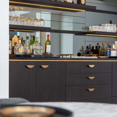 Large trendy single-wall light wood floor wet bar photo in Sydney with an integrated sink, flat-panel cabinets, black cabinets, solid surface countertops, mirror backsplash and black countertops