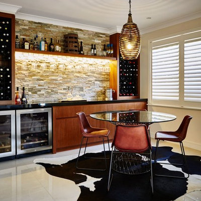 Inspiration for a contemporary single-wall white floor home bar remodel in Central Coast with flat-panel cabinets, medium tone wood cabinets and beige backsplash