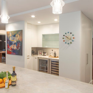 Small contemporary single-wall wet bar in Detroit with flat-panel cabinets, white cabinets, marble worktops, dark hardwood flooring, brown floors and grey worktops.