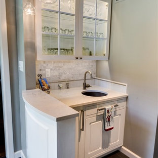 Photo of a small contemporary single-wall wet bar in Wichita with white cabinets, a submerged sink, raised-panel cabinets, marble worktops, grey splashback, stone tiled splashback and slate flooring.