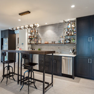 Trendy single-wall gray floor wet bar photo in Portland with an undermount sink, shaker cabinets, black cabinets, gray backsplash and white countertops