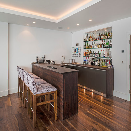 Photo Of A Contemporary U Shaped Breakfast Bar In London With Flat Panel  Cabinets