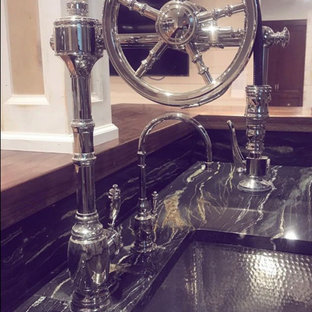 Inspiration for a traditional l-shaped wet bar with a submerged sink.