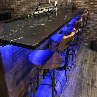 Home bar - industrial home bar idea in Atlanta