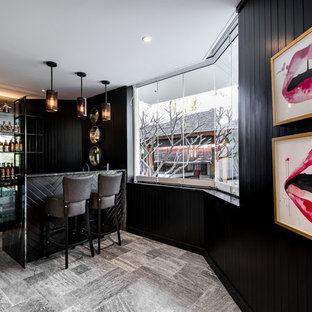 Inspiration for a mid-sized modern l-shaped ceramic floor seated home bar remodel in Perth with open cabinets, black cabinets, marble countertops and black backsplash