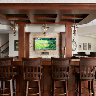 Seated home bar - large traditional u-shaped vinyl floor and brown floor seated home bar idea in Minneapolis with recessed-panel cabinets, dark wood cabinets, wood countertops, beige backsplash and brown countertops