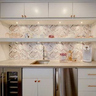 Design ideas for a transitional single-wall wet bar in Austin with an undermount sink, flat-panel cabinets, white cabinets, pink splashback and grey benchtop.