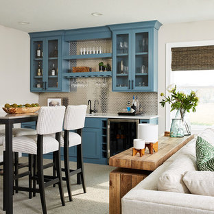 Inspiration for a transitional single-wall carpeted and gray floor wet bar remodel in Minneapolis with shaker cabinets, blue cabinets, gray backsplash, metal backsplash and white countertops