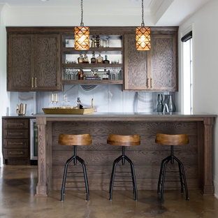Example of a transitional galley brown floor seated home bar design in Nashville with shaker cabinets, dark wood cabinets and multicolored backsplash