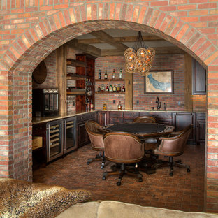 Mountain style u-shaped brick floor and brown floor home bar photo in Minneapolis with raised-panel cabinets, dark wood cabinets, granite countertops, brown backsplash and brick backsplash