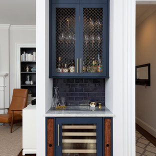 Photo of a small traditional single-wall home bar in Charlotte with shaker cabinets, blue cabinets, blue splashback, metro tiled splashback, dark hardwood flooring, brown floors and white worktops.