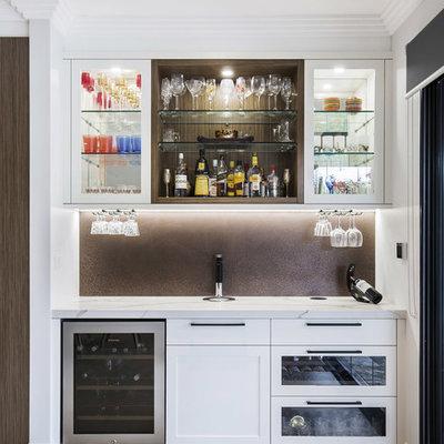 Small minimalist single-wall limestone floor and beige floor wet bar photo in Sydney with shaker cabinets, white cabinets, quartz countertops, no sink, brown backsplash and metal backsplash
