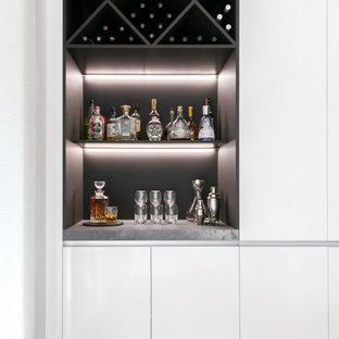 Design ideas for a contemporary home bar in Sydney.