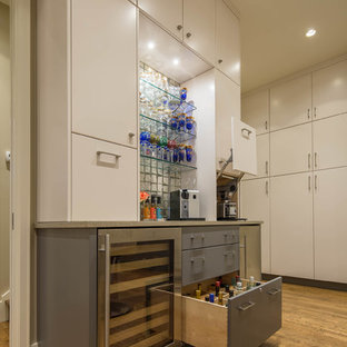 Inspiration for a mid-sized modern single-wall light wood floor wet bar remodel in Austin with no sink, flat-panel cabinets, gray cabinets, quartz countertops and glass tile backsplash