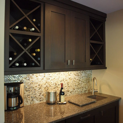 Mid-sized trendy single-wall seated home bar photo in Chicago with an undermount sink, shaker cabinets, dark wood cabinets, brown backsplash and mosaic tile backsplash