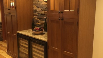 Kitchen with stone and wine fridges