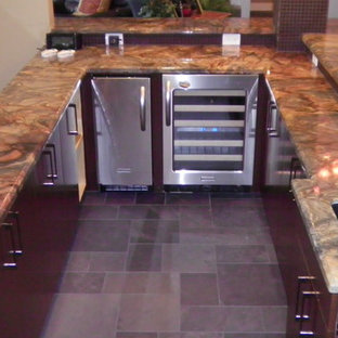 This is an example of a medium sized classic u-shaped breakfast bar in Houston with a submerged sink, flat-panel cabinets, dark wood cabinets, brown splashback and grey floors.