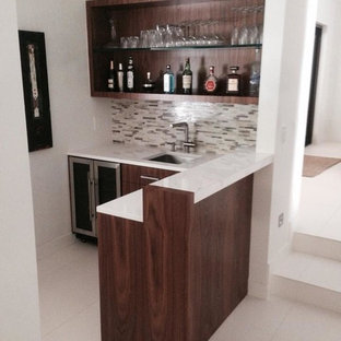 Home bar - small transitional l-shaped ceramic floor home bar idea in Miami with an undermount sink, multicolored backsplash, stone tile backsplash, dark wood cabinets, quartz countertops and flat-panel cabinets