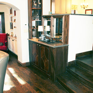 Photo of a classic home bar in Denver with raised-panel cabinets, white cabinets and dark hardwood flooring.