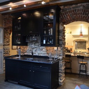 Large traditional single-wall wet bar in Philadelphia with a submerged sink, shaker cabinets, black cabinets, marble worktops, slate flooring, stone tiled splashback and brown floors.