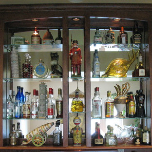 Example of a mid-sized classic l-shaped seated home bar design in Other with an undermount sink, open cabinets, dark wood cabinets and wood countertops
