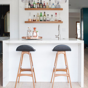 Design ideas for a small contemporary galley breakfast bar in Orange County with a submerged sink, marble worktops, medium hardwood flooring and brown floors.