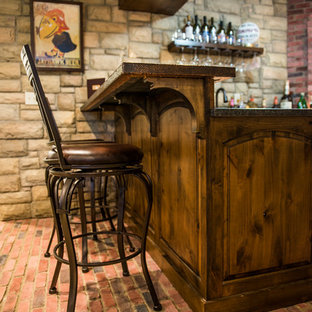 Inspiration for a medium sized rustic u-shaped breakfast bar in Kansas City with brick flooring, red floors, a submerged sink, raised-panel cabinets, dark wood cabinets, red splashback and brown worktops.